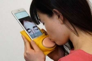Magic! Meet Kissenger, The Smartphone Accessory That Lets You Kiss Your Partner Even if You